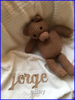Hand-embroidered and personalized baby towel