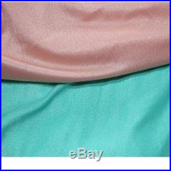 fabric has peach pink or turquoise bathing suit